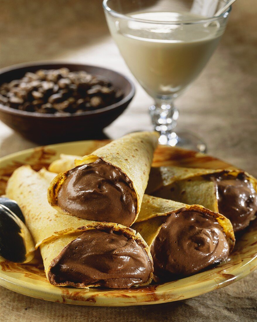 Crepes with chocolate mousse filling; mocha beans; coffee cream