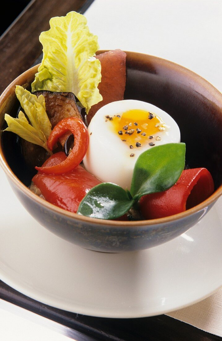 Soft-boiled egg with marinated vegetables and fish