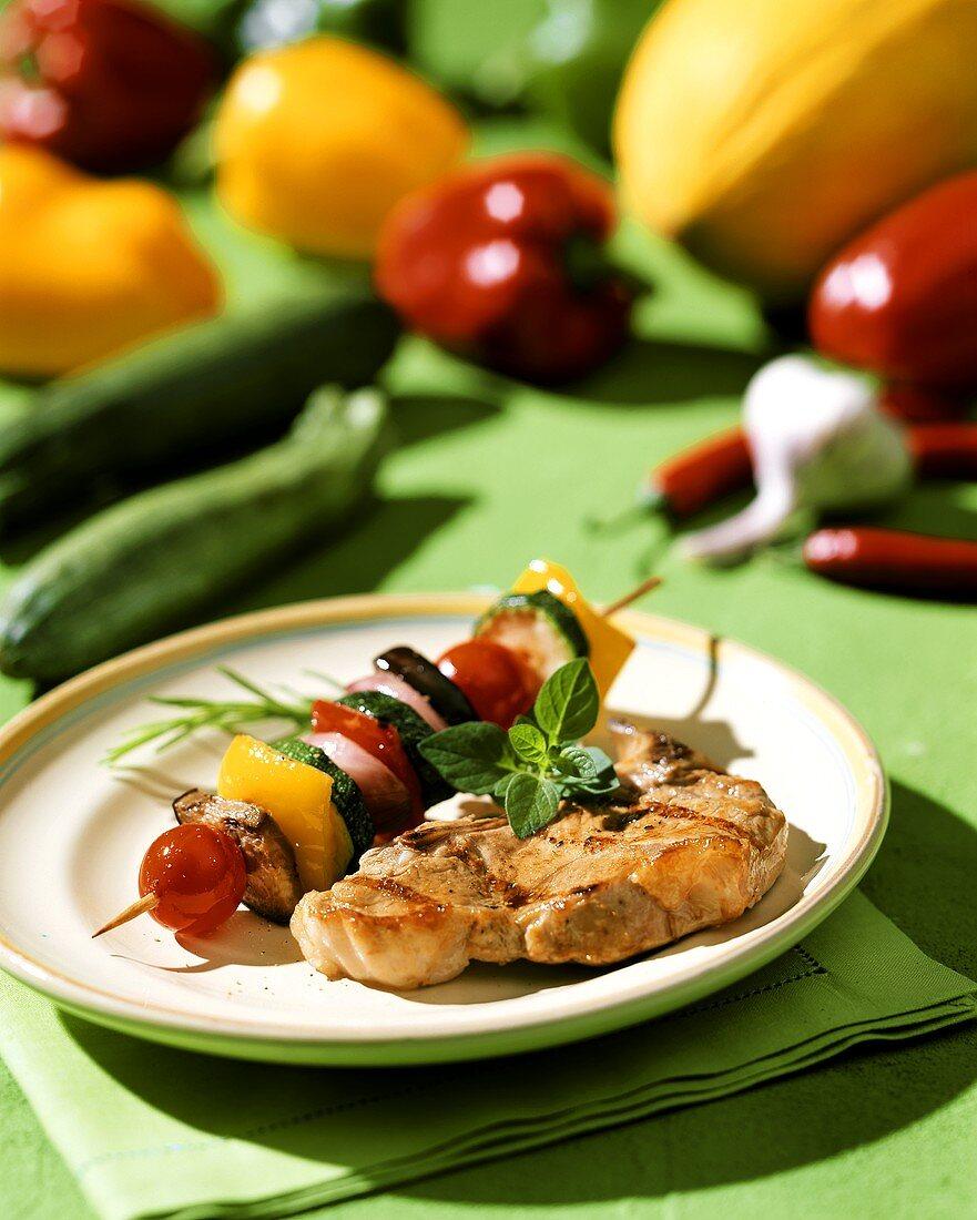 Barbecued pork chop with colourful vegetable kebab