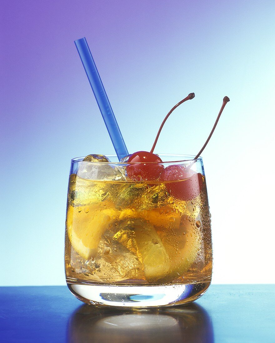 Old fashioned: cocktail with whisky, oranges & cherries
