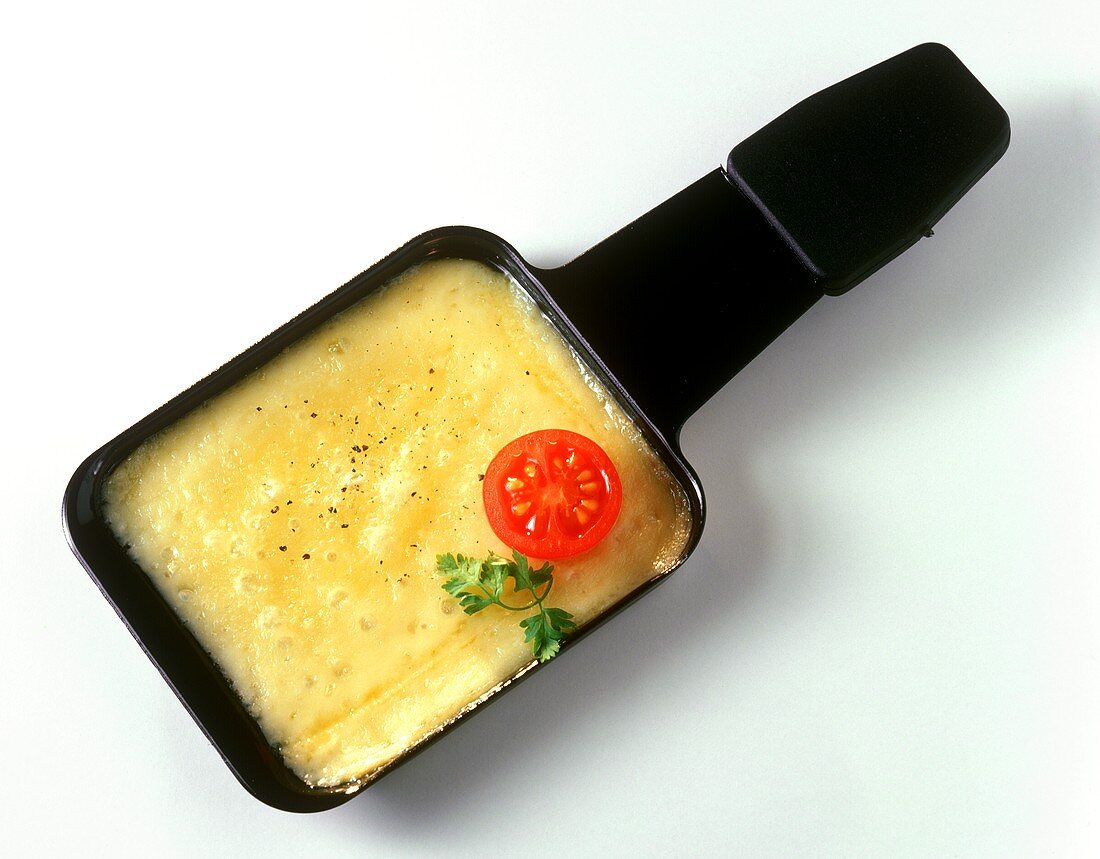 Raclette cheese in raclette dish