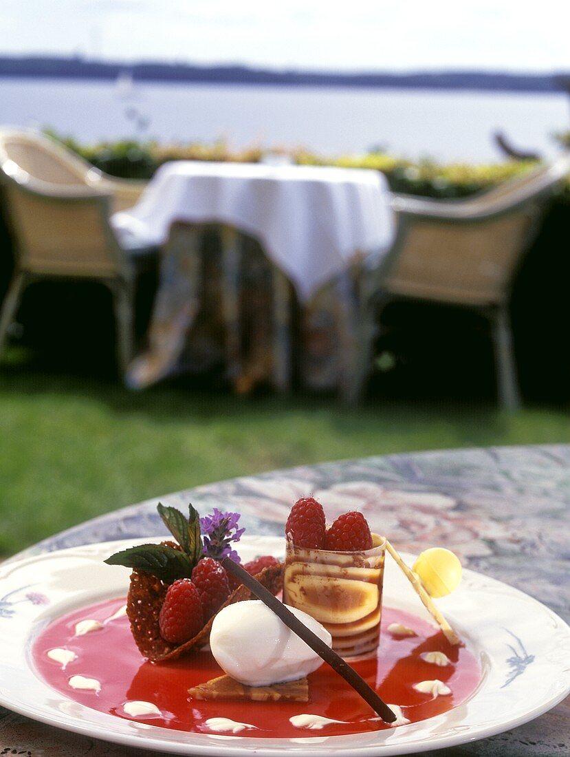 Raspberry dessert with ice cream on sun terrace of café