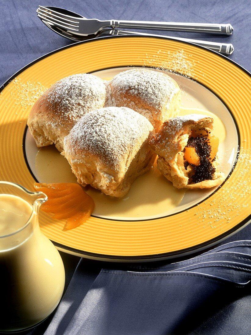 Poppy seed rolls (Buchteln) with apricots in custard