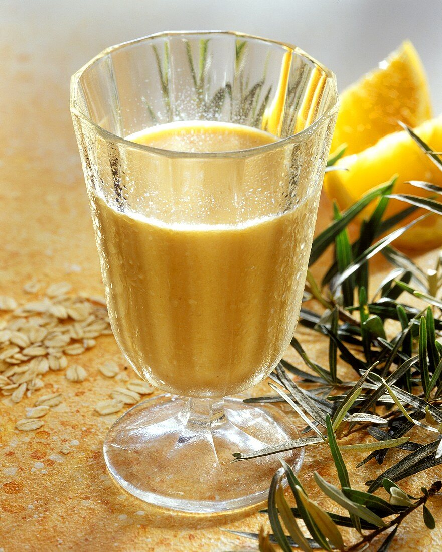 Orange and sea buckthorn berry drink with rolled oats