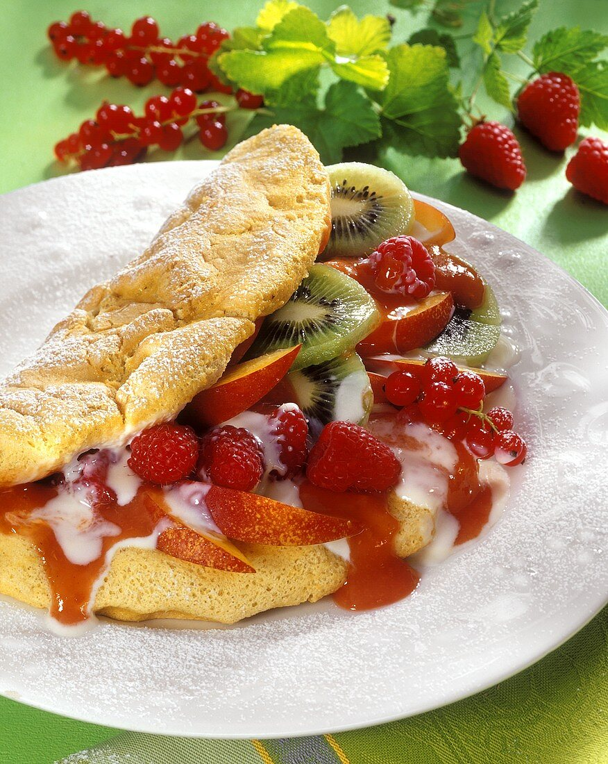Omelette with fruit and yoghurt sauce