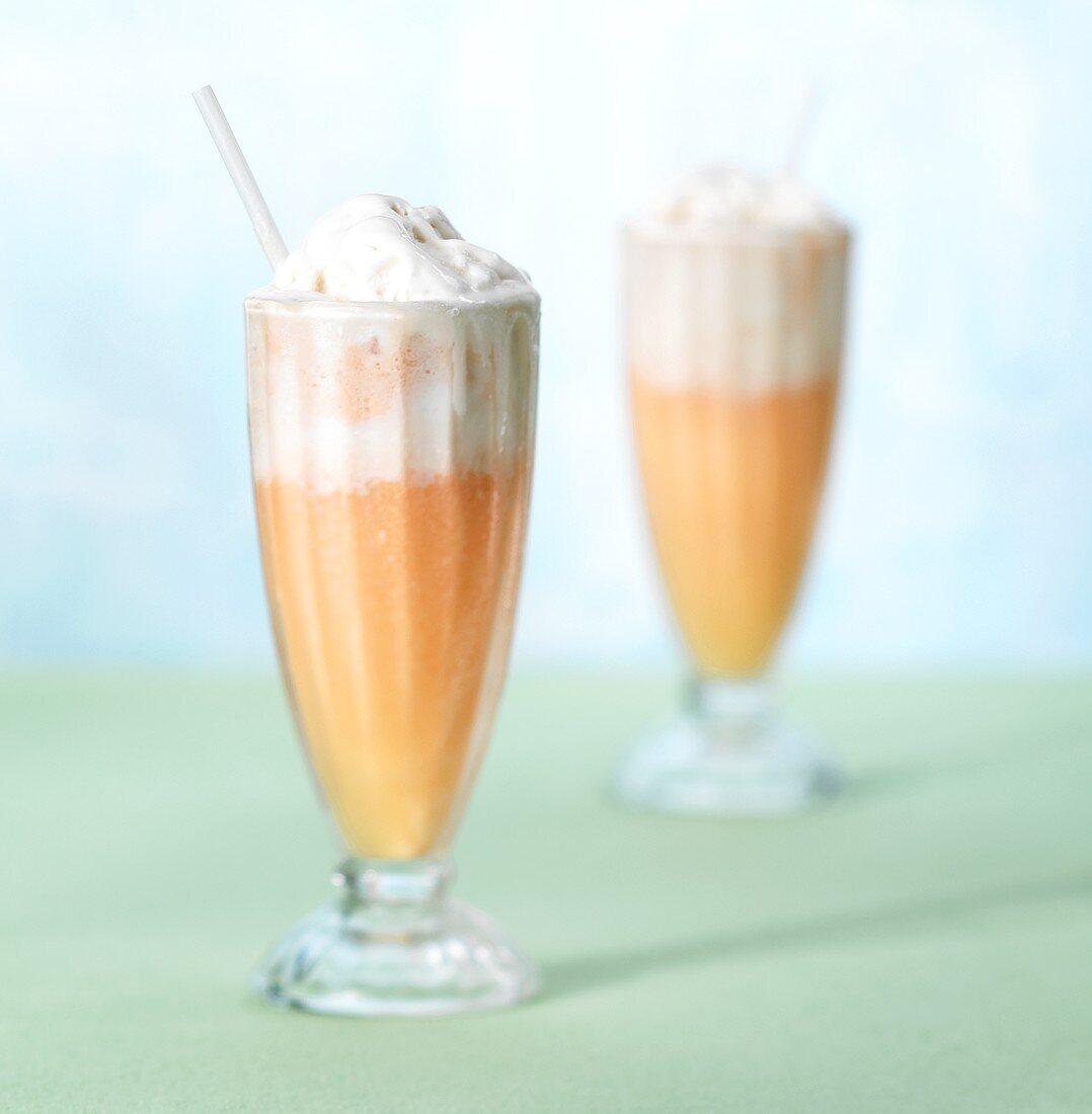 Orange shake with ice cream in glasses