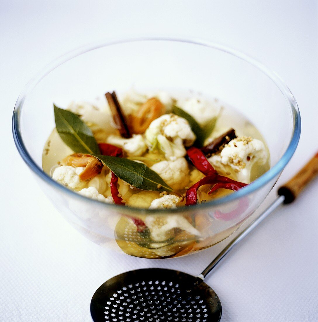 Pickled cauliflower with spices in glass dish