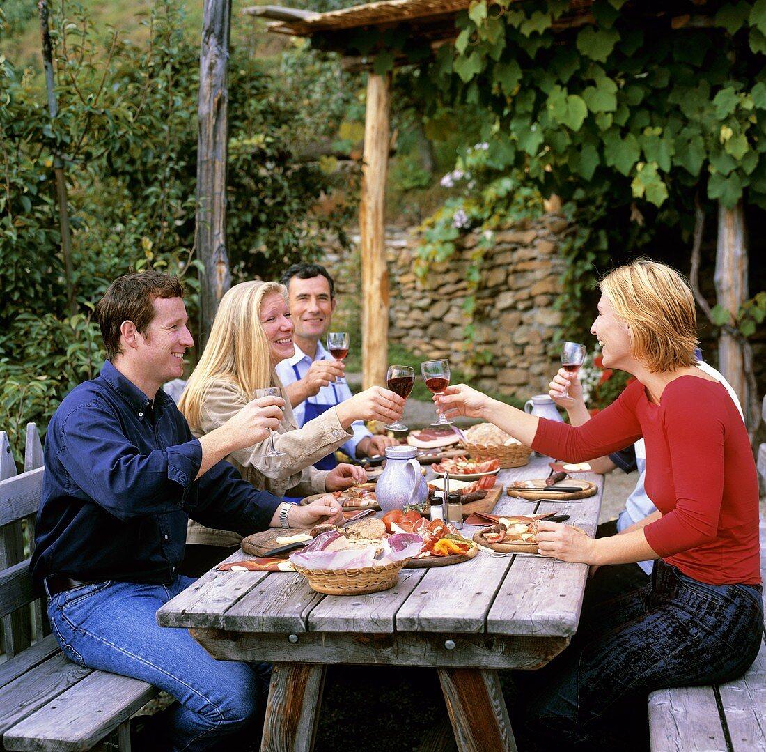 People with snack & wine (S. Tyrolean wine festival: Törggelen)