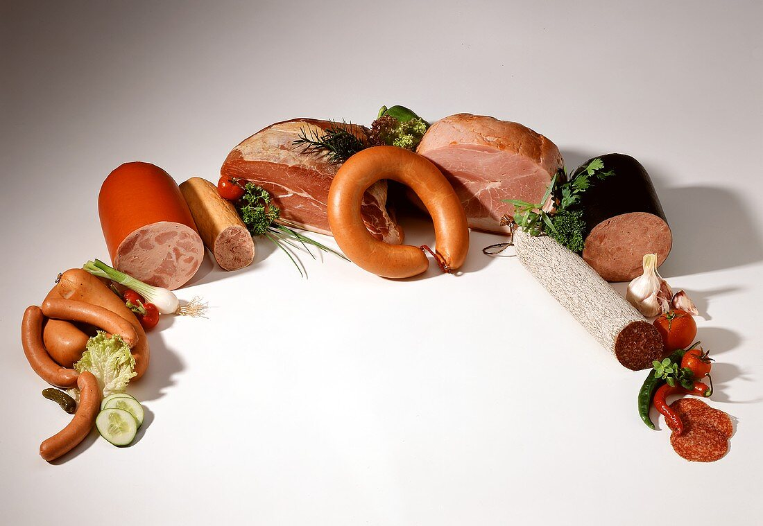 Various sausages and hams arranged in an arc