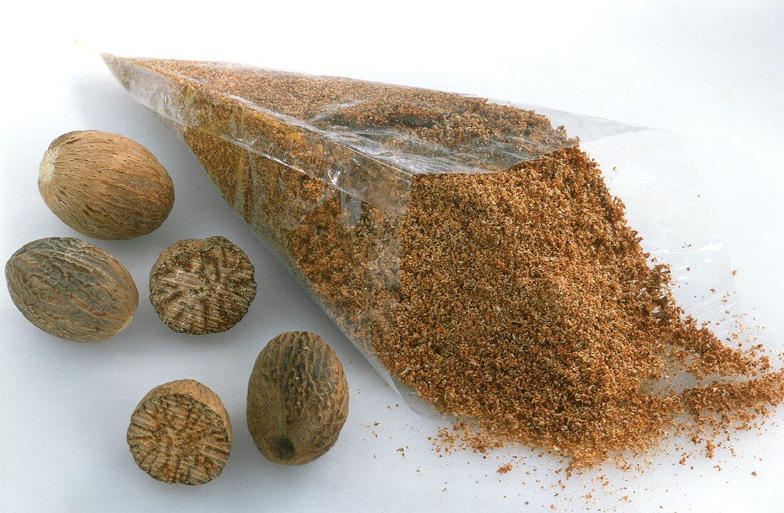 Nutmegs and cellophane bag of ground nutmeg