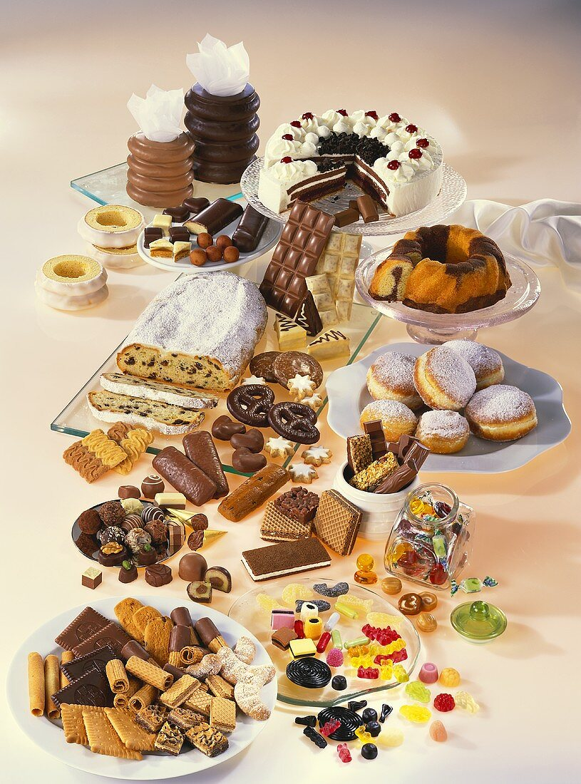 Still life with sweets, cakes, doughnuts and confectionary