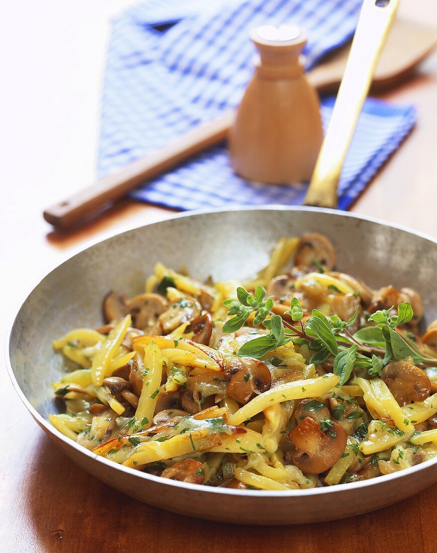 Pan-cooked potato and mushroom dish with cheese