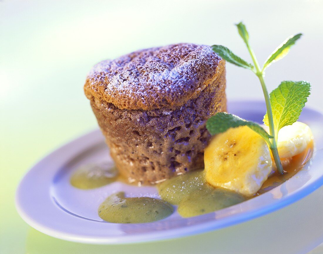 Chocolate soufflé with bananas and mint sauce
