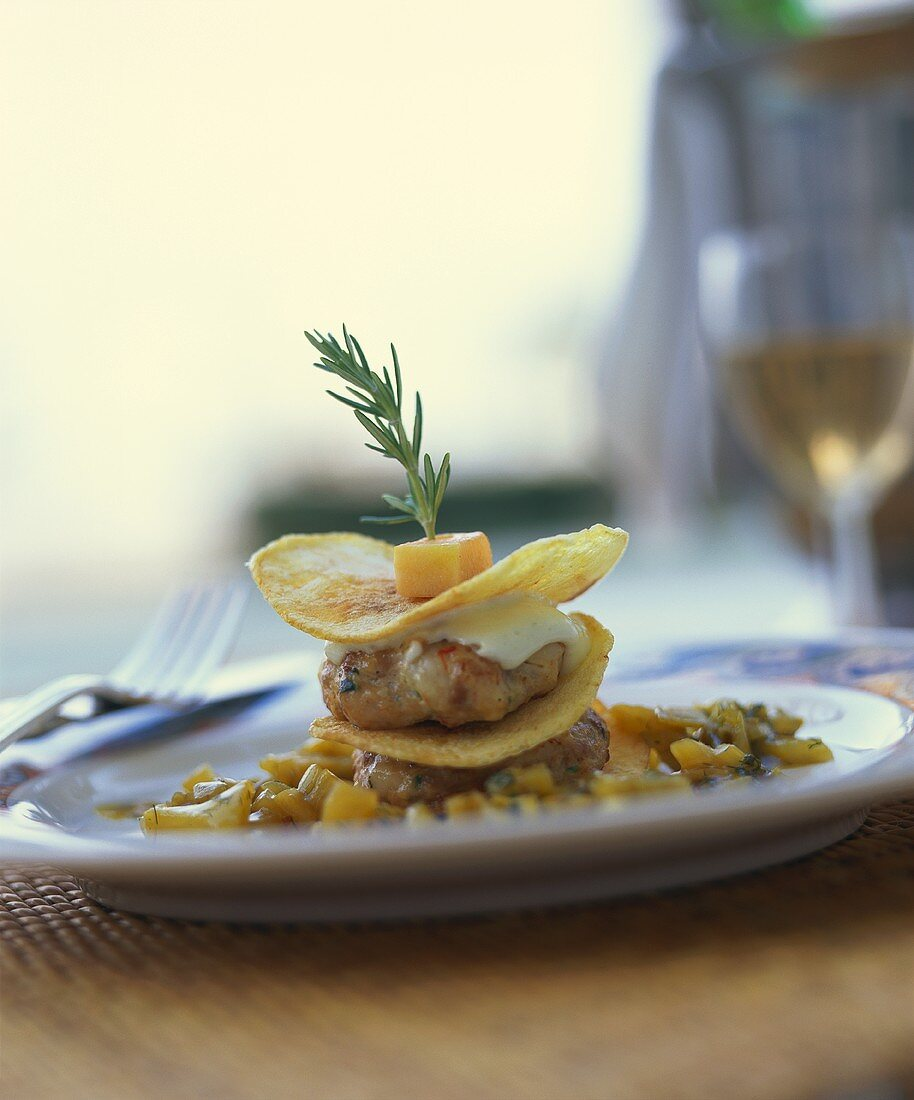 Scampi and guinea-fowl rissoles with pancakes in pumpkin ragout
