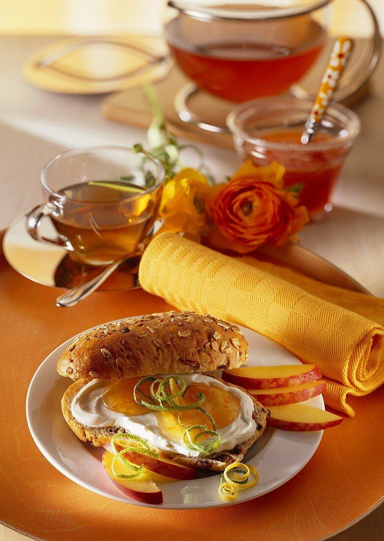 Granary roll with quark and jam; nectarines; tea