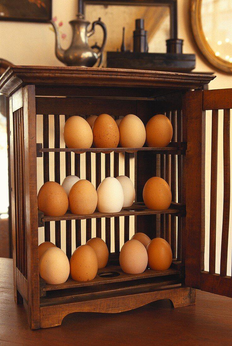 Eggs in wooden cabinet