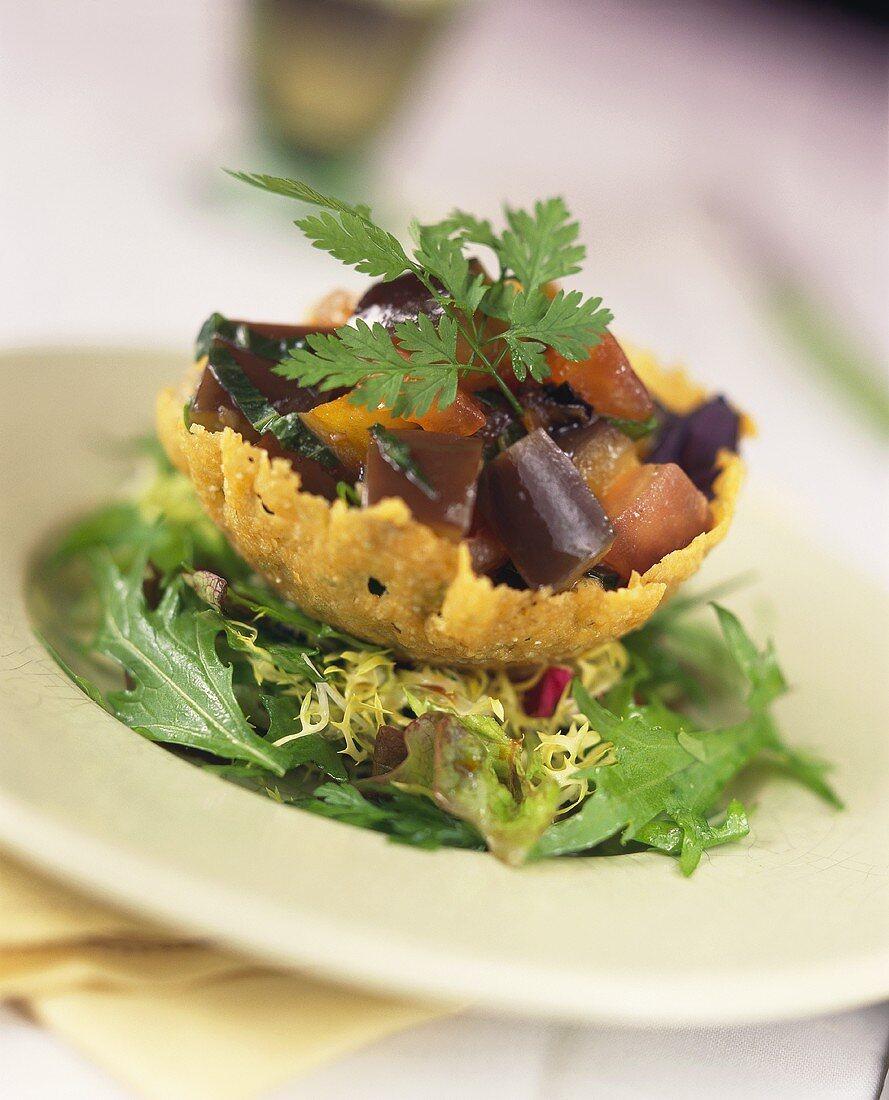 Aubergine salad in crispy Parmesan bowl