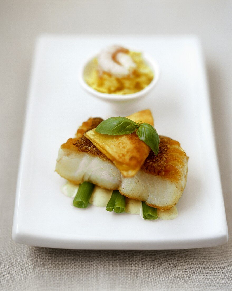 Cod with won ton on butter sauce
