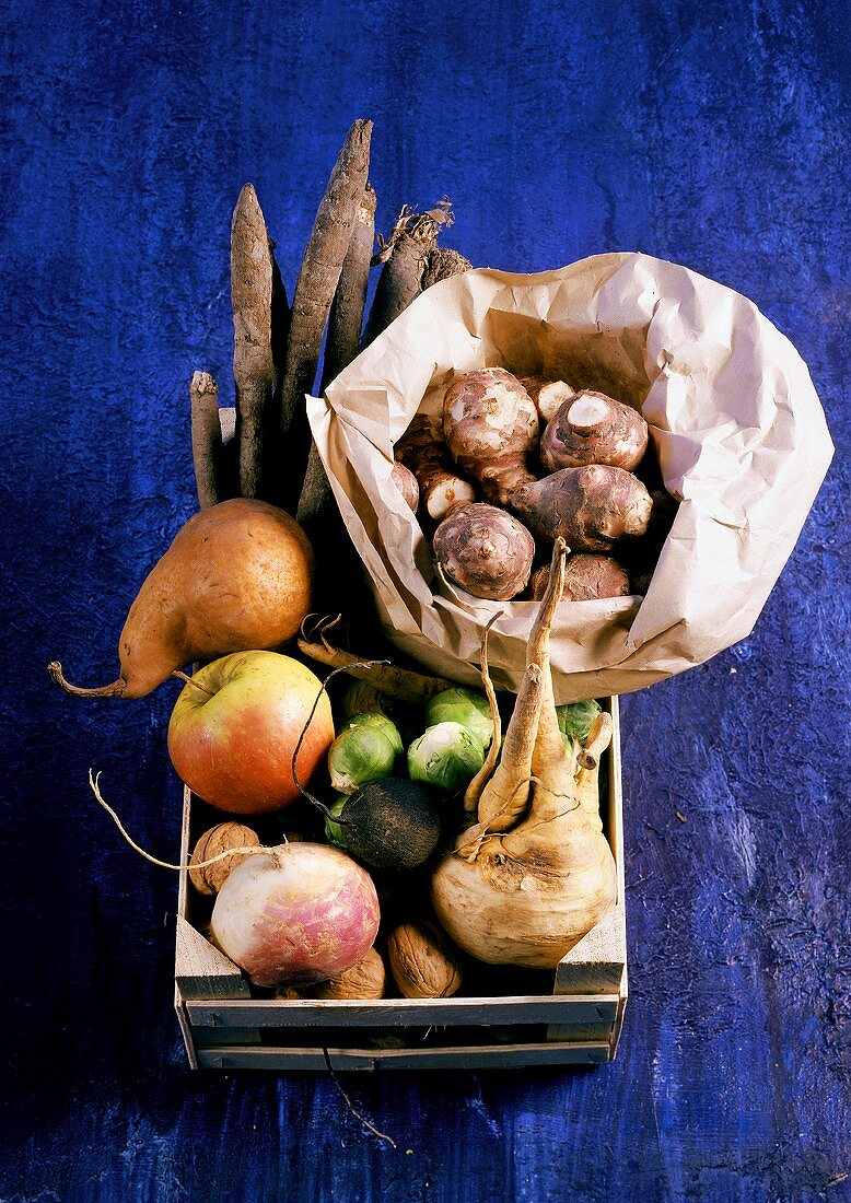 Winter vegetables, fruit and nuts in crate