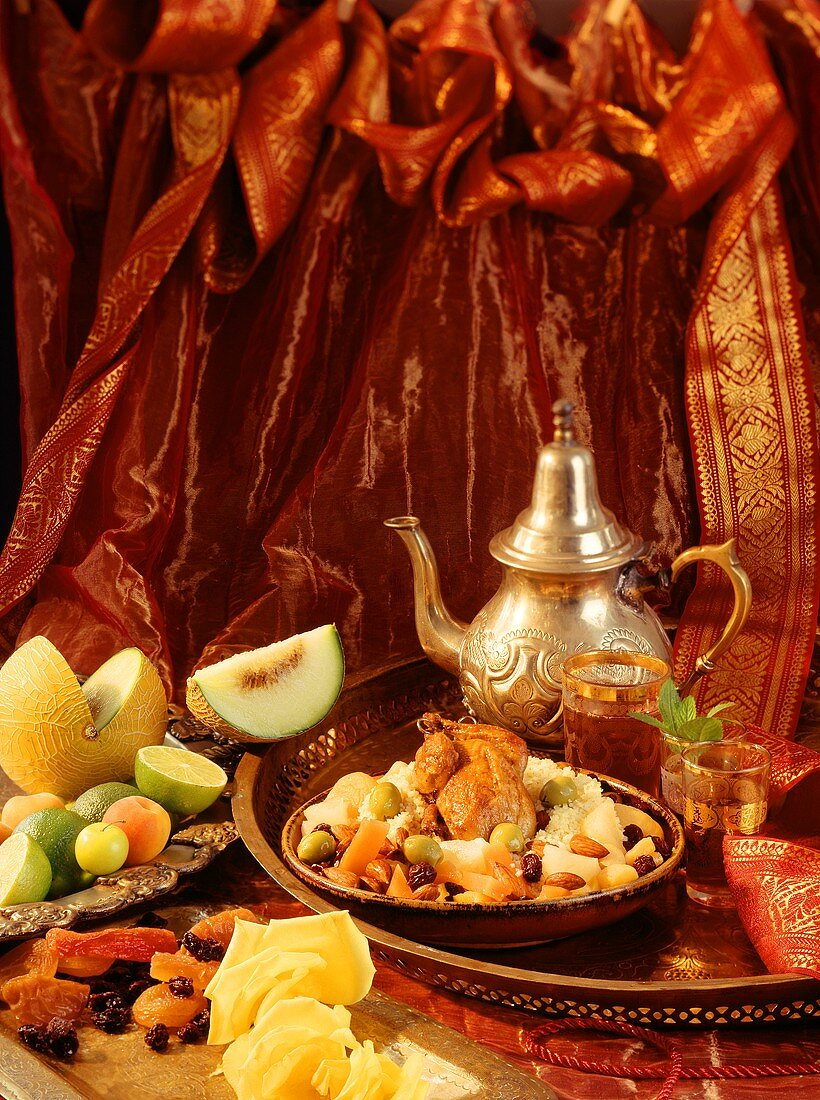 Middle Eastern meal with quail, couscous, fruit and tea