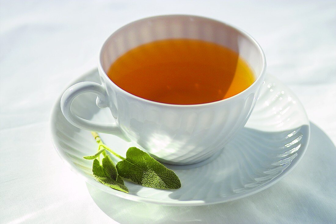 Sage tea in white cup