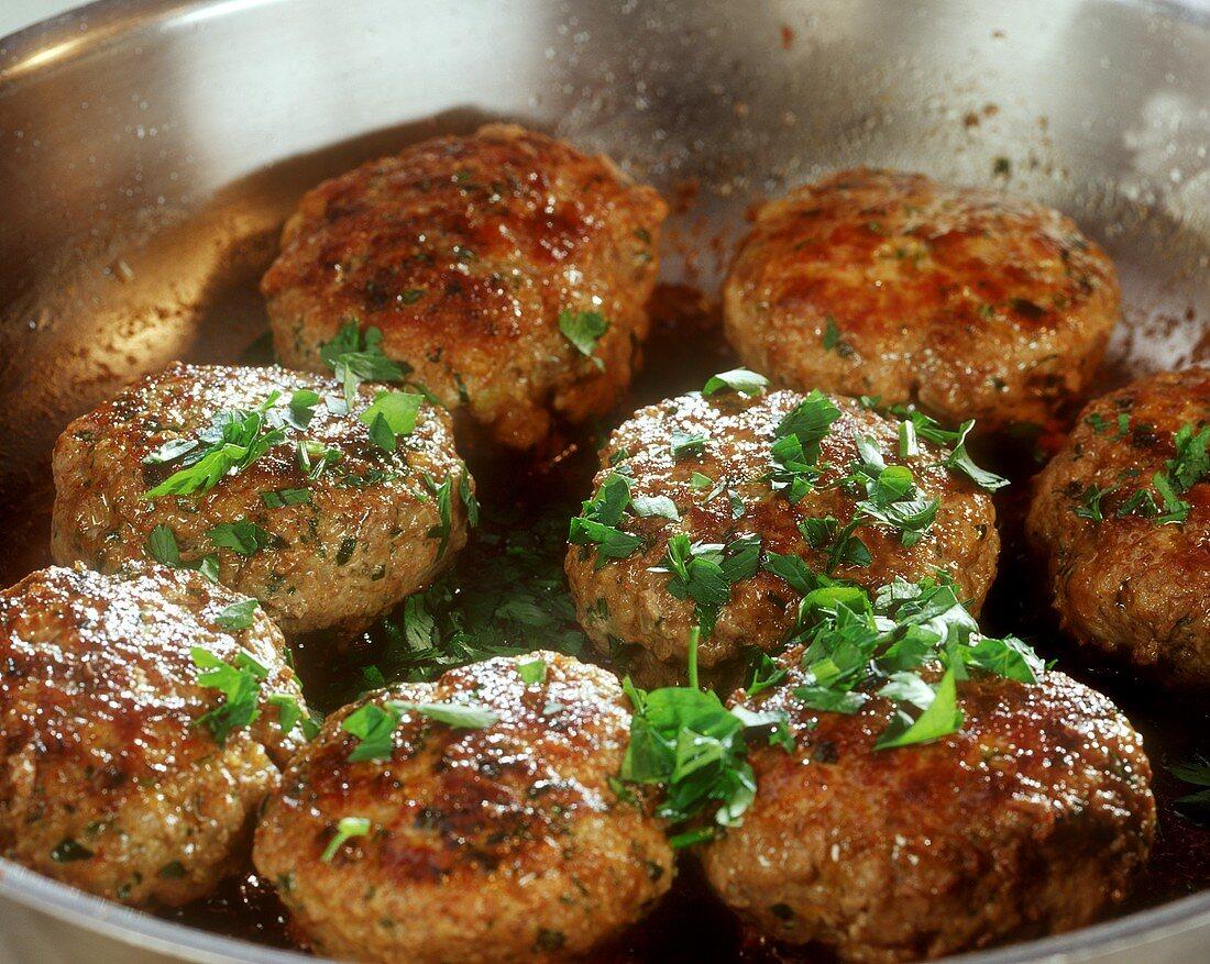 Rissoles in frying pan