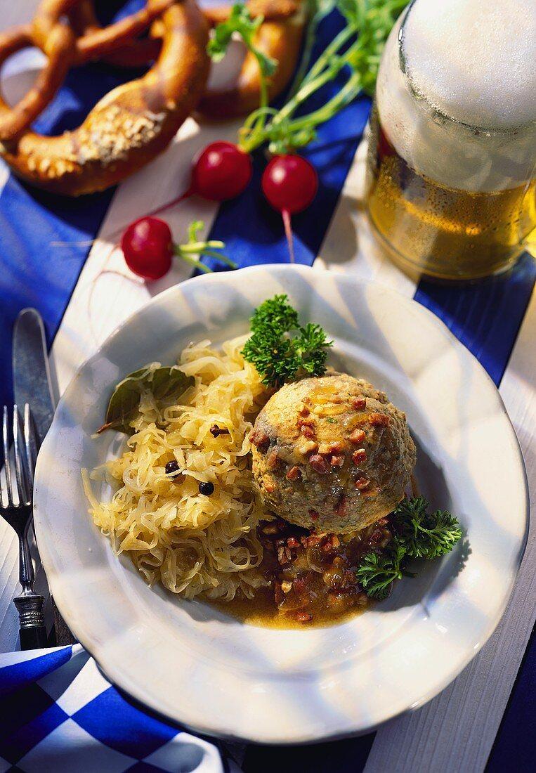 Liver dumplings with sauerkraut; beer; pretzels