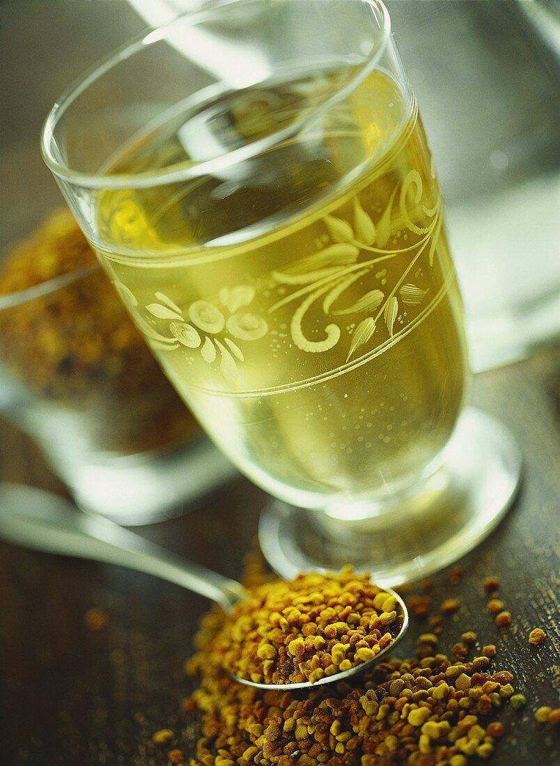 Saffron tea in glass; saffron on spoon