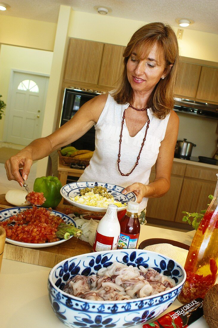 Woman cooking Brazilian cuttlefish dish