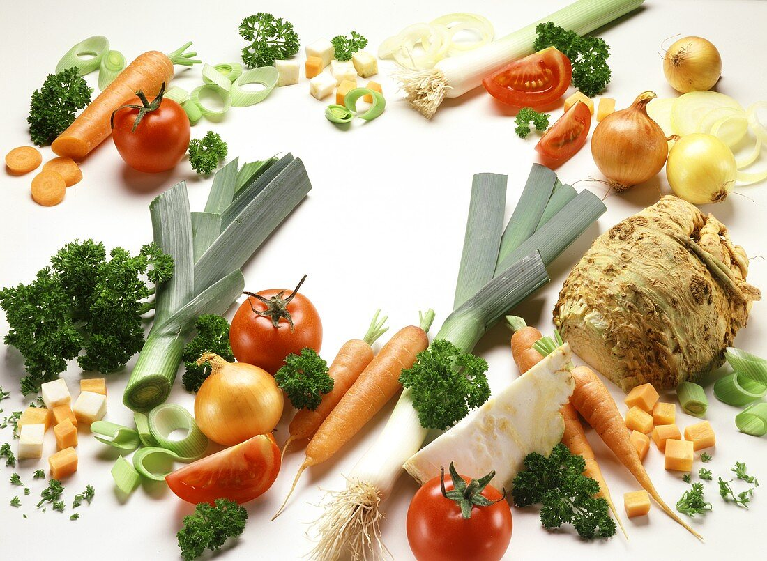 Various types of vegetables grouped around edge of picture