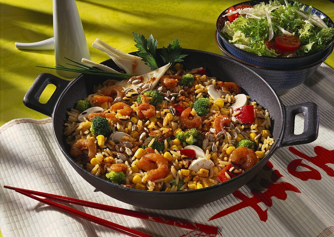 Asian pan-cooked rice dish with vegetables and shrimps