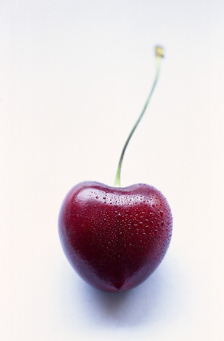 Heart cherry with drops of water