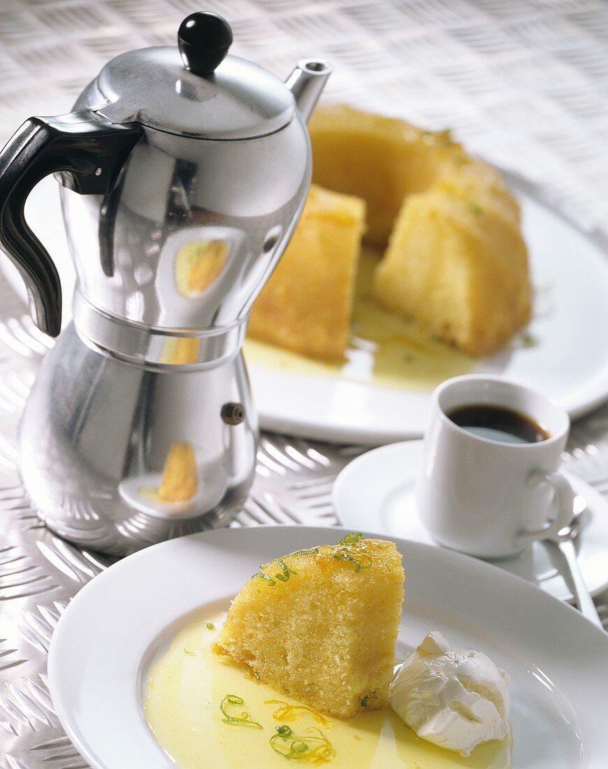 Lime savarin, cup of espresso and espresso pot