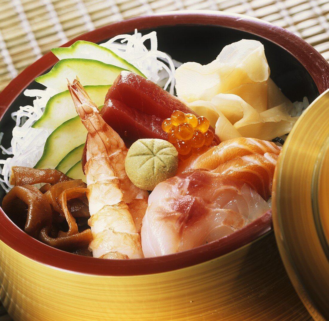 Chirashi sushi with mixed fish in bamboo baskets