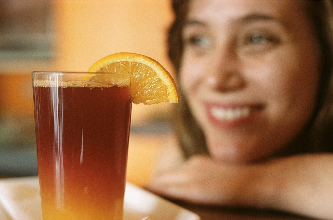 Laughing woman with a cocktail