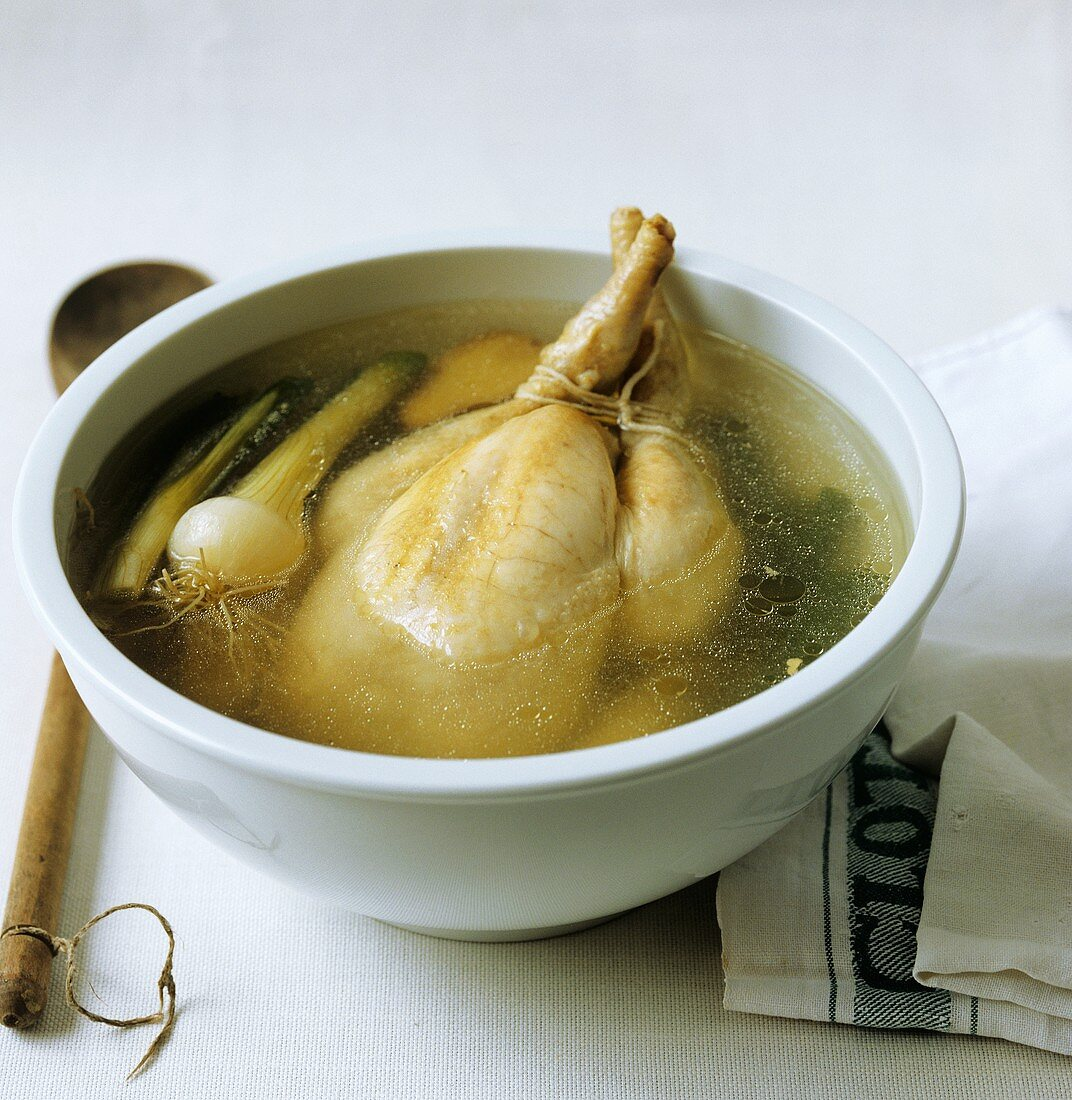 Making chicken broth: boiling fowl in bowl