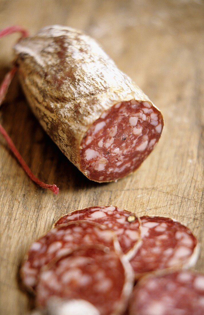 A hard cured sausage, slices cut