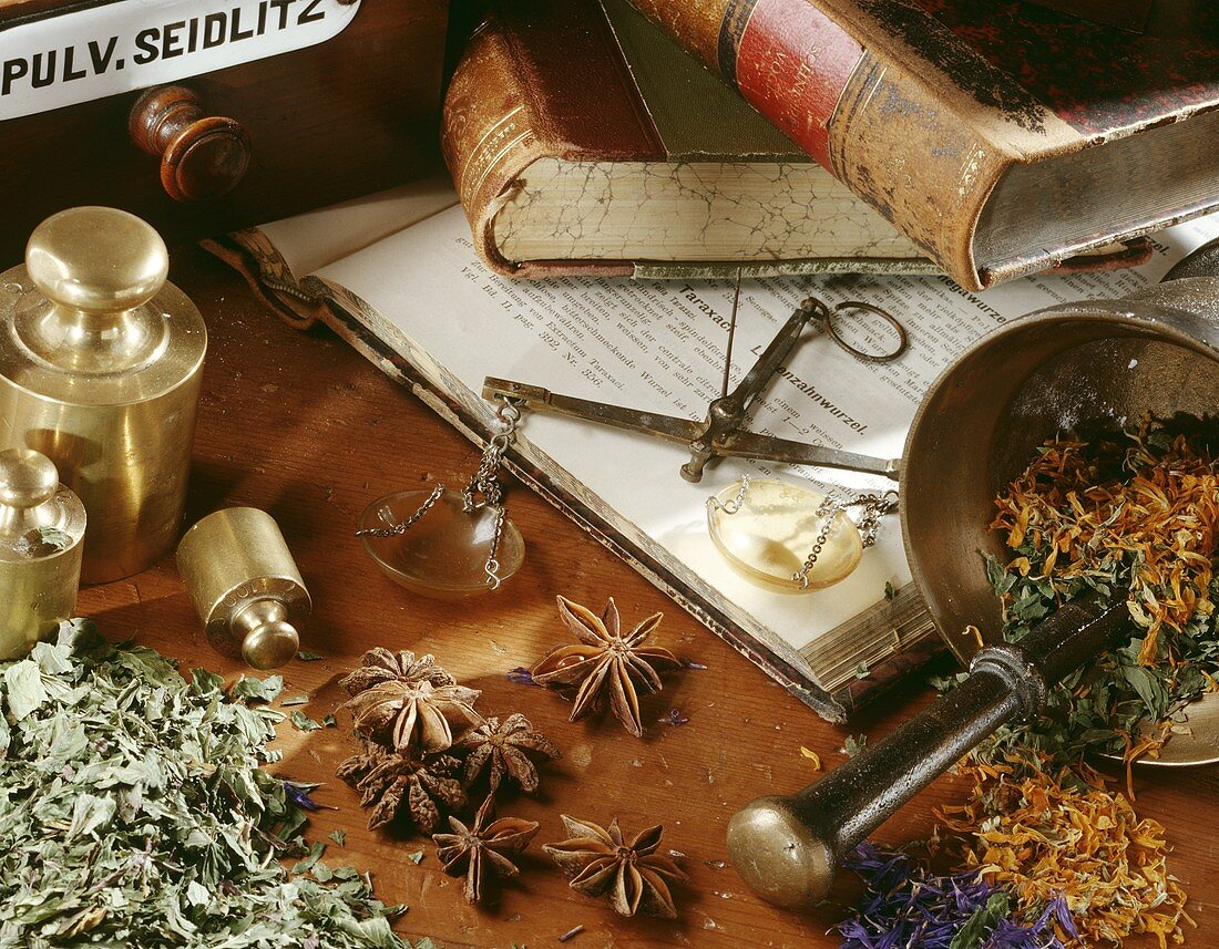 Still life with spices, herbs and mortar