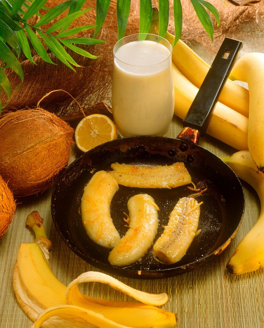 Fried bananas in the pan, with banana milk