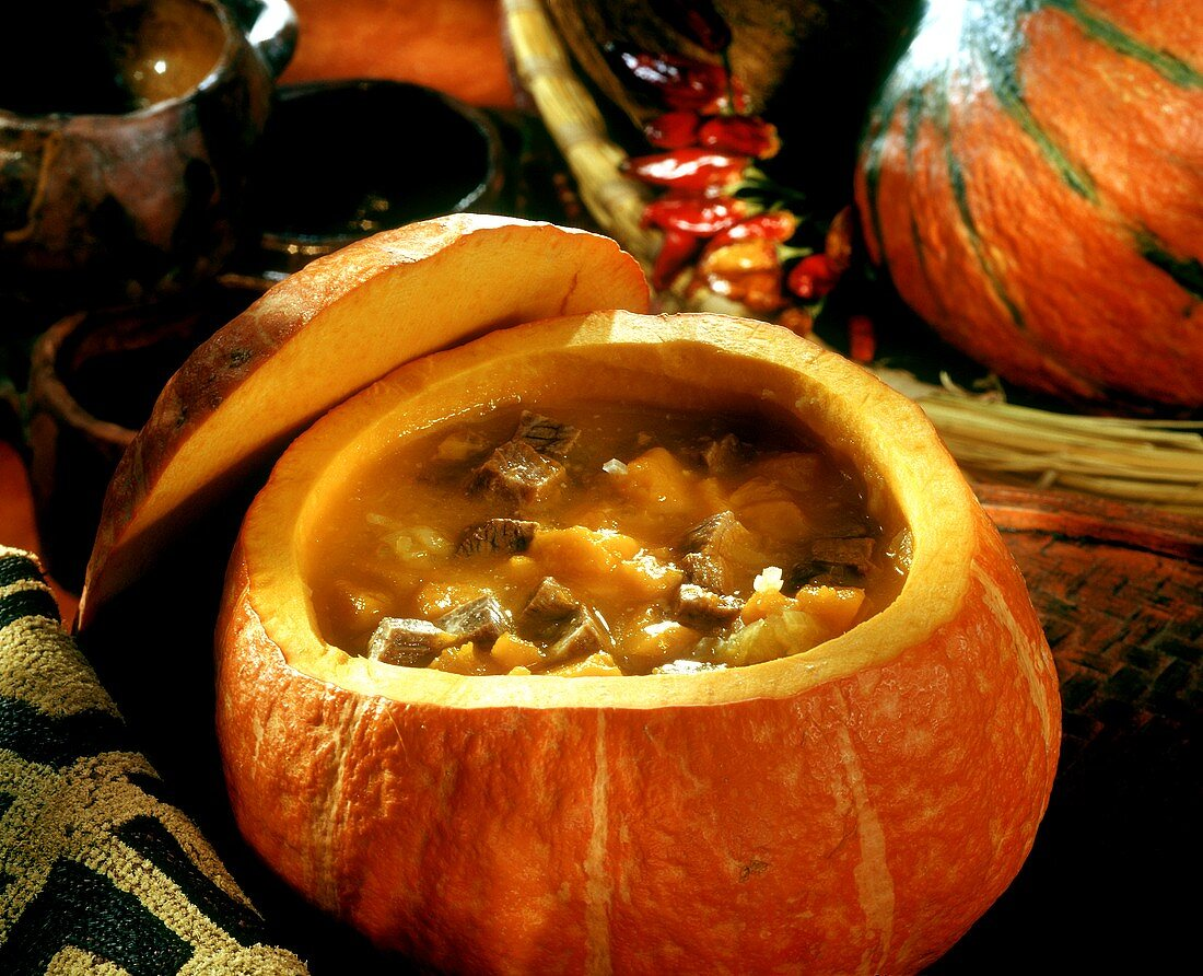 Pumpkin and meat soup in a hollowed out pumpkin (Tanzania)