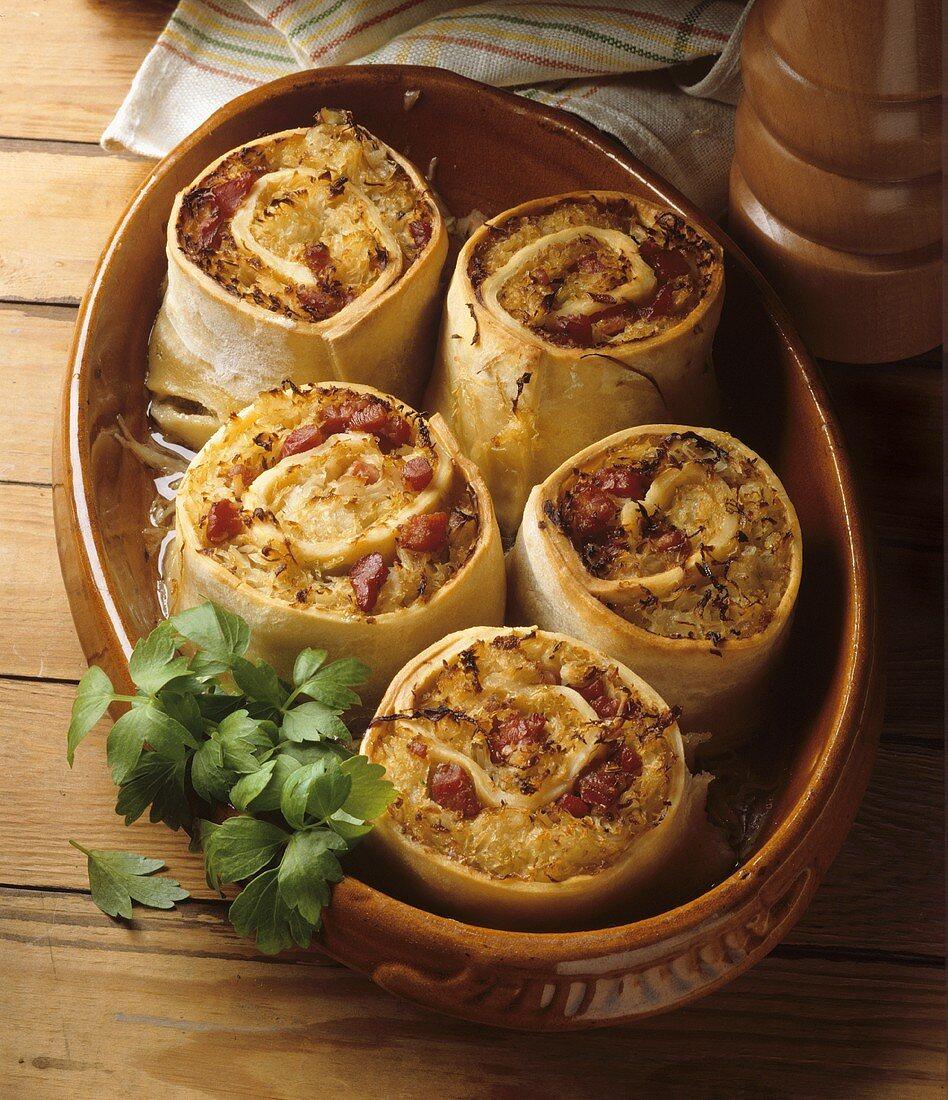 Krautkrapfen (pastry rolls with sauerkraut) in ovenproof dish
