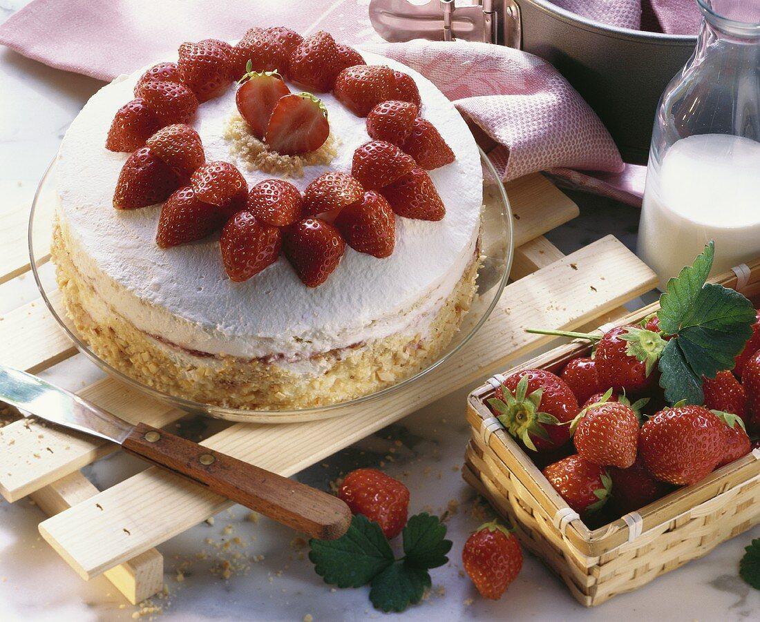A strawberry cream gateau and fresh strawberries