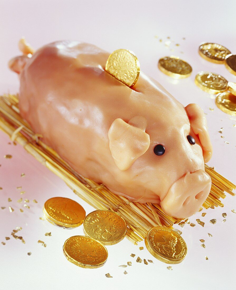Piggy bank with chocolate pennies for children