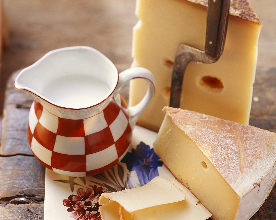 Still life with Swiss cheese and jug of milk