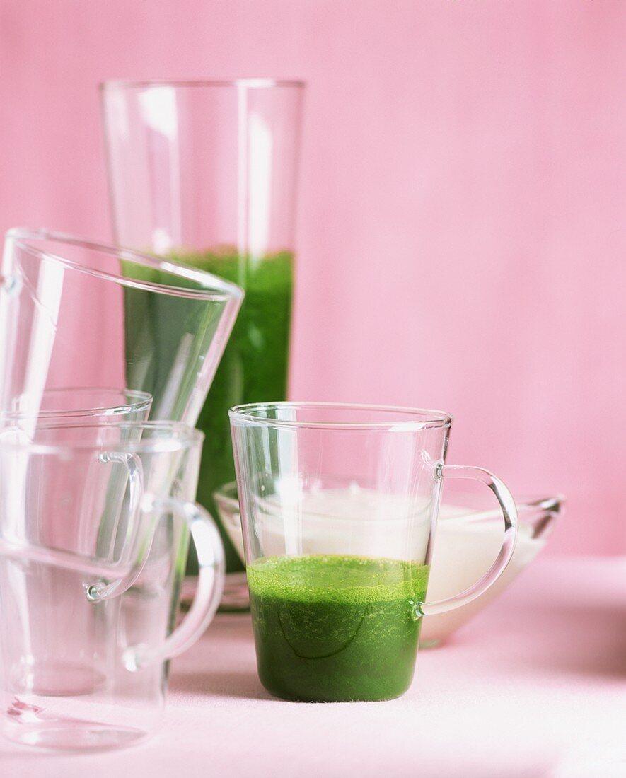 Freshly pressed wheatgrass juice in glasses