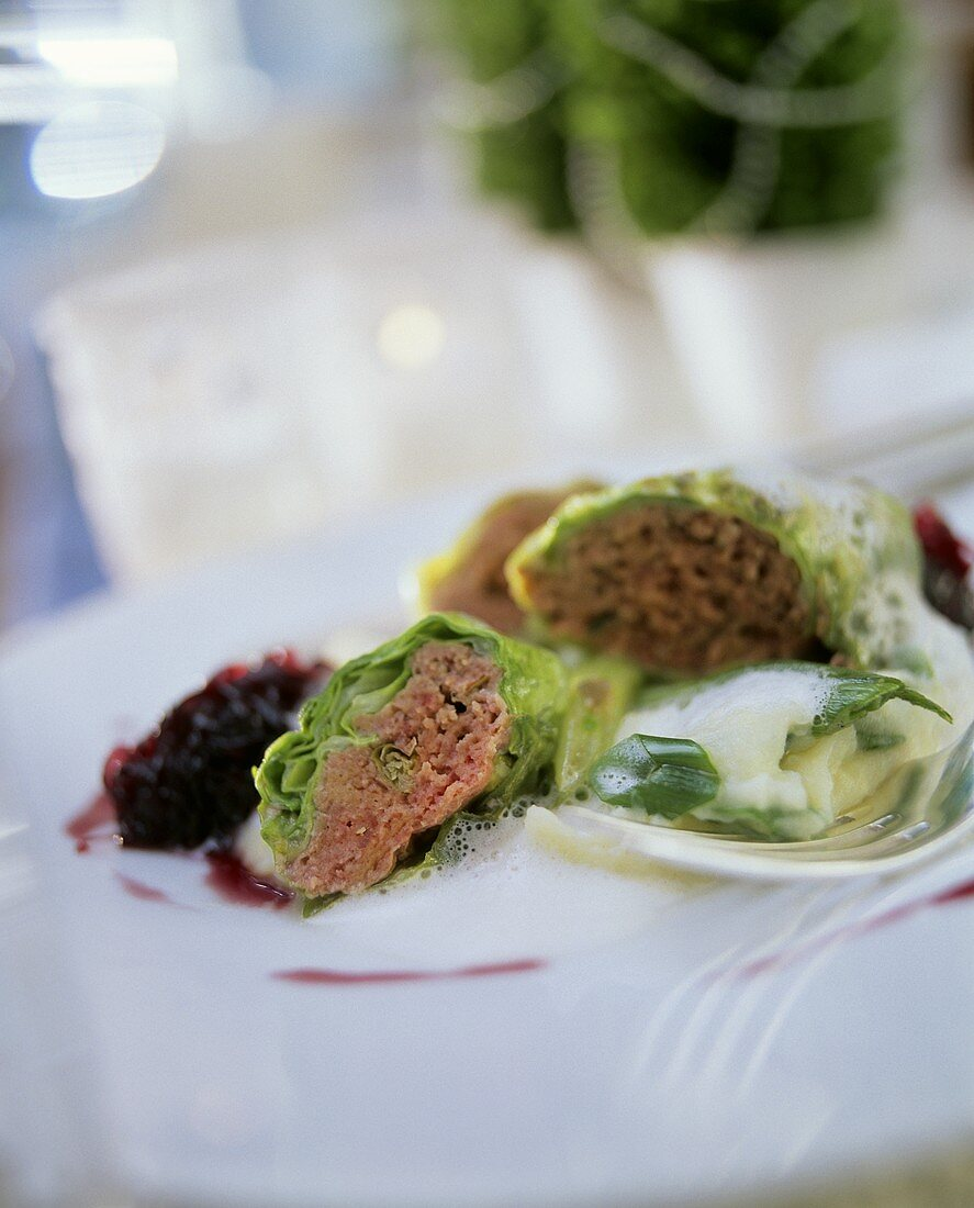 Cabbage roulade with minced lamb in white wine sauce