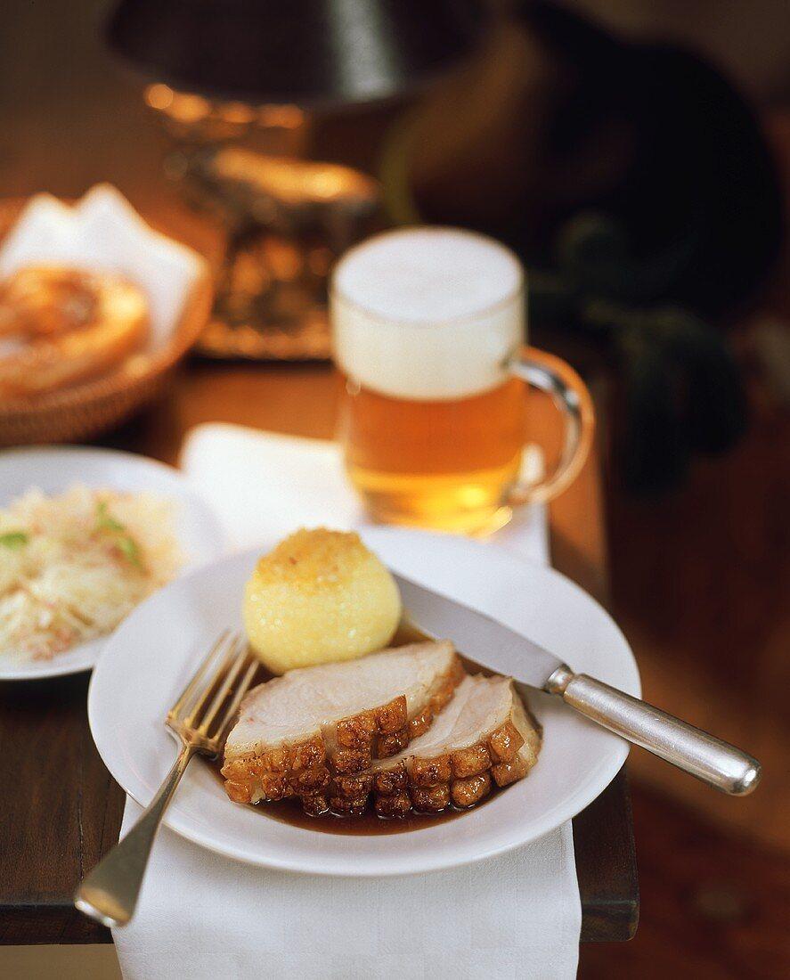 Roast pork with crackling, with potato dumpling; beer