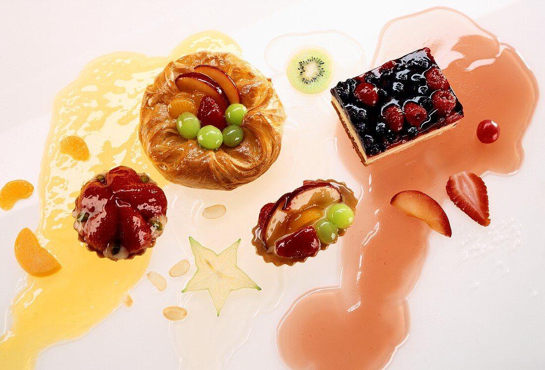 Danish pastries, fruit tarts, berry cake and cake glaze