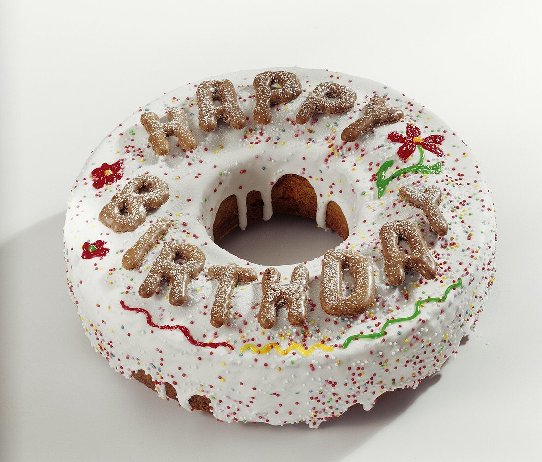 Ring cake with glace icing and 'Happy Birthday'
