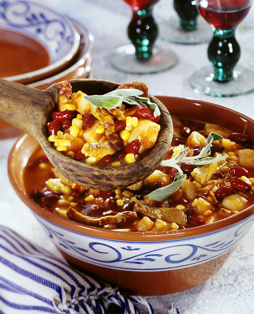 Hearty pan-cooked bean dish with veal and sweetcorn